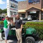 Coastal Carts Gives Back by donating new cart to Camp Challenge